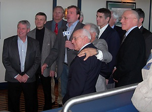 Members of the 1972 team are interviewed while watching the 2006 team's Olympic opener versus Latvia.