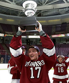 Harvard sophomore Tyler Magura hoists the Crimson's third Whitelaw Trophy in five years. (photo: Age Manocchia)