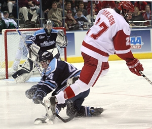 Ross Carlson sidesteps a Maine defender just before scoring a pivotal shorthanded goal. (photo: Neil Ament)