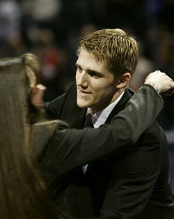 Matt Carle embraces his mother after being named the 2006 Hobey Baker Award winner. (photo: Christopher Guess/Daily Cardinal)