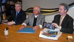 Authors Jerry and Tom Caraccioli flank 1972 coach Murray Williamson at Wednesday's book signing.