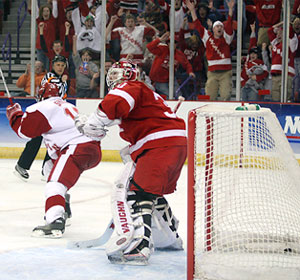 Jack Skille scores in the third overtime to send Wisconsin to its first Frozen Four since 1992. (photos: Neil Ament)