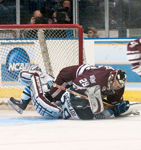 Brent Shepheard collides with UMass goalie Jon Quick in Saturday's regional final. (photo: Jeff Wang)