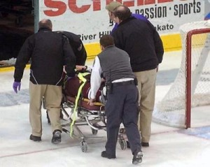 Tom Pohl was taken off the ice on a stretcher Sunday. (photo: Mankato Free Press)