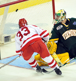 BU\'s Colin Wilson scores the second of his two goals, in leading his team to a 5-4 win over Vermont. (photo: Josh Gibney)