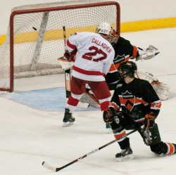 Colin Greening beats Princeton\'s Zane Kalemba in double OT to get Cornell to the ECAC final. (photo: Adriano Manocchia)