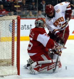 Patrick Mullen moves in on the Wisconsin net during Denver\'s 3-0 win. (photo: Scott Pierson)