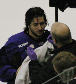 Minnesota State goalie Mike Zacharias gets taken care of after getting cut on the forehead during overtime (photos: Ryan Coleman).