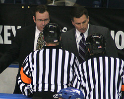 Referees try to explain to Air Force\'s coaching staff what happened on the play.