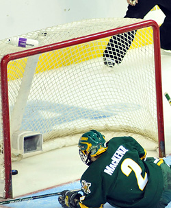 Drew McKenzie dives to try to break up a play, but the puck wound up deflecting off his stick and in, tying the game, at the time, 4-4. (photo: Josh Gibney)