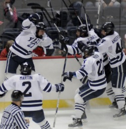 Matt Nelson is mobbed by teammates after the game winner.