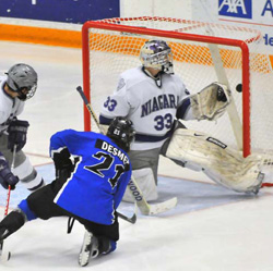 Keenan Desmet scores the OT game winner to send Alabama-Huntsville to the NCAAs. (photo: Douglas Eagan)