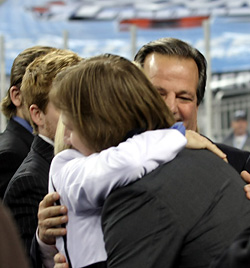 Geoffrion embraces his parents. (photo: Joe Koshollek)