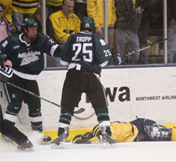 Corey Tropp stands over Michigan\'s Steve Kampfer after Tropp\'s dirty hit last January that led to him getting dismissed from the Spartans.