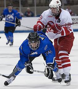 Reilly Smith of Miami battles Kevin Morrison of UAH. (photo: Karen Winger)
