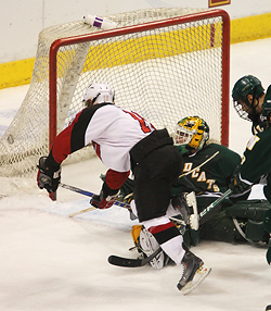 SCSU\'s Ryan Lasch scores in the first period for the Huskies. (photo: Ryan Coleman)