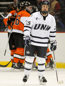 UNH defenseman Mike Beck despairs over another RIT goal. (photo: Brad Pettengill)