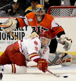 Jared DeMichiel fends off Denver\'s Rhett Rakhshani during RIT\'s NCAA East Regional sweep. (photo: Brad Pettengill)