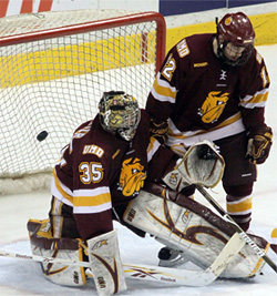 UMD\'s Kenny Reiter allows the third-period shorthanded goal that stood up as the winner, by Jason Gregoire. (photo: Ryan Coleman)