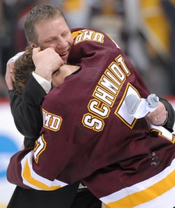 UMD coach Scott Sandelin celebrates with Kyle Schmidt, who scored the OT game winner. (photo: Ryan Coleman)