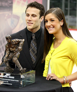 Andy Miele poses with the Hobey Baker Award with his girlfriend. (photo: Ryan Coleman/d3photography.com)