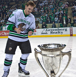 Jason Gregoire accepts the MacNaughton Cup, though is careful not to touch it. (photo: Brad Olson)