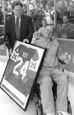 Travis Roy and his father, Lee, when Travis\' number was retired, at old Walter Brown Arena.