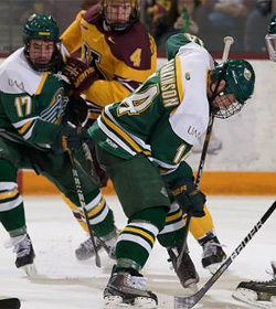 UAA senior assistant captain Craig Parkinson battles a pair of Gophers. (photo: Jim Rosvold/Univ. of Minnesota)