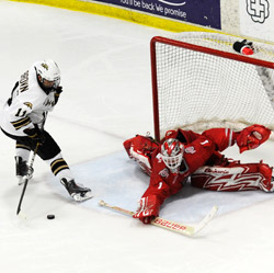 Dennis Brown scores a shootout goal against Ohio State\'s Cal Heeter earlier this year. (photo: GS Photo)