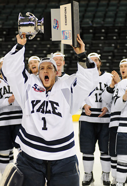 Ryan Rondeau hoists the Whitelaw Trophy after Yale shut out Cornell 6-0 for the ECAC title. (photo: Brad Pettingill)