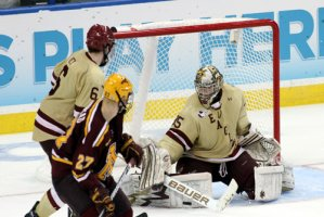 BC\'s Parker Milner turns aside a shot from Minnesota power forward Nick Bjugstad. Milner made 30 saves in the Eagles\' national semifinal win. (Neil Ament)