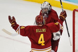 Ferris State senior defenseman Chad Billins celebrates with netminder Taylor Nelson during Thursday\'s Frozen Four victory over Union (Joe Koshollek)
