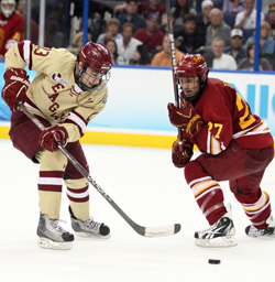 Johnny Gaudreau (left) makes a dazzling move around Ferris State defender Brett Wysopal on his way to scoring the clinching goal in Saturday\'s national championship game. (photo: Neil Ament)