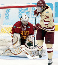 BC's Paul Carey redirects the puck over the right shoulder of FSU goaltender Taylor Nelson. (photo: Neil Ament)