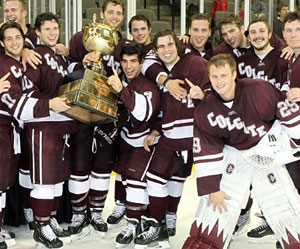 Colgate players celebrate with the Maverick Stampede trophy.