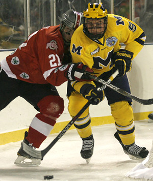 Michigan\'s Luke Moffatt battles for control.