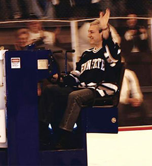 Just-fired Penn State president Graham Spanier, riding a zamboni during a club game, following the announcement that the school would start a varsity program.