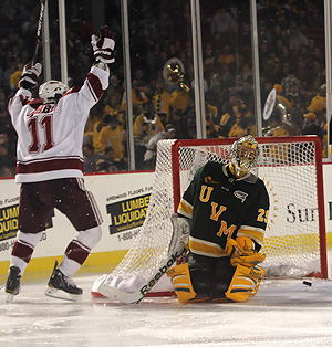 Danny Hobbs scores on Vermont goalie Rob Madore. (photo: Karen Winger)