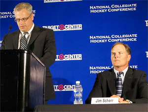 NCHC commissioner Jim Scherr, right, listens to Target Center vice president and general manager Steve Mattson talk during Monday\'s press conference at Target Center in Minneapolis. (photo Eric Stromgren)