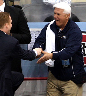 Equipment Manager Ed Maturo (right) congratulates Quinnipiac coach Rand Pecknold after the team\'s NCAA semifinal win Thursday. (photo: Neil Ament)