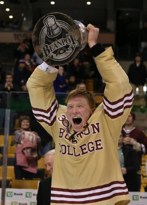 BC captain Patrick Brown celebrates a fifth straight title for the Eagles. (photo: Jon Quackenbos/Boston College)