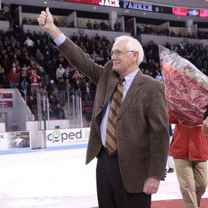 Former BU coach Jack Parker acknowledges the crowd during a ceremony Friday to retire his numnber.
