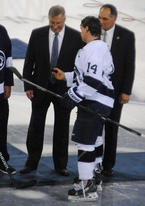 Terry Pegula (l.) and Joe Battista help drop the ceremonial first puck, with the help of Penn State's Tommy Olczyk.