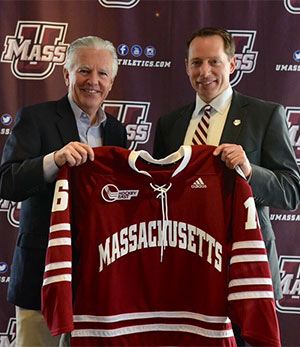 New UMass coach Greg Carvel (right) with UMass chancellor Marty Meehan.