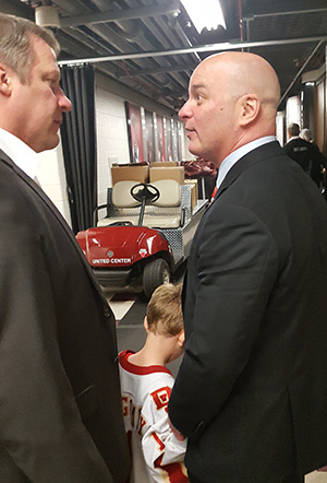 Denver coach Jim Montgomery (right) and Minnesota-Duluth coach Scott Sandelin shared a moment in the tunnel after the game, talking appreciatively about how good the game was.