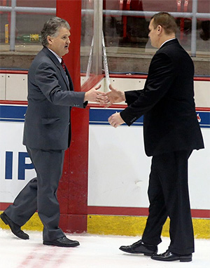Cornell coach Mike Schafer (left) and Union coach Rick Bennett shake hands after the game. (photo: Robert Dungan)