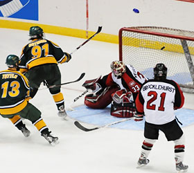 Shea Guthrie roofs a backhand over St. Cloud goalie Jase Weslosky to give Clarkson the lead it wouldn't relinquish. (photo: Brad Pettengill)