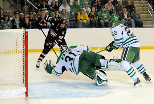 North Dakota's Zane McIntyre makes a big stop to keep his team on top of St. Cloud State. (photo: Russ Hons)