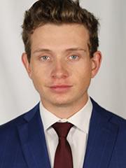 Michal Stinil headshot