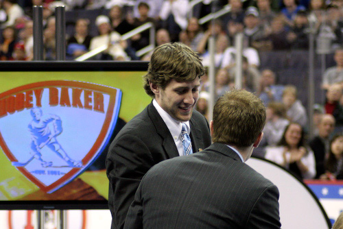 Matt Gilroy comes up to accept his Hobey Baker Award.